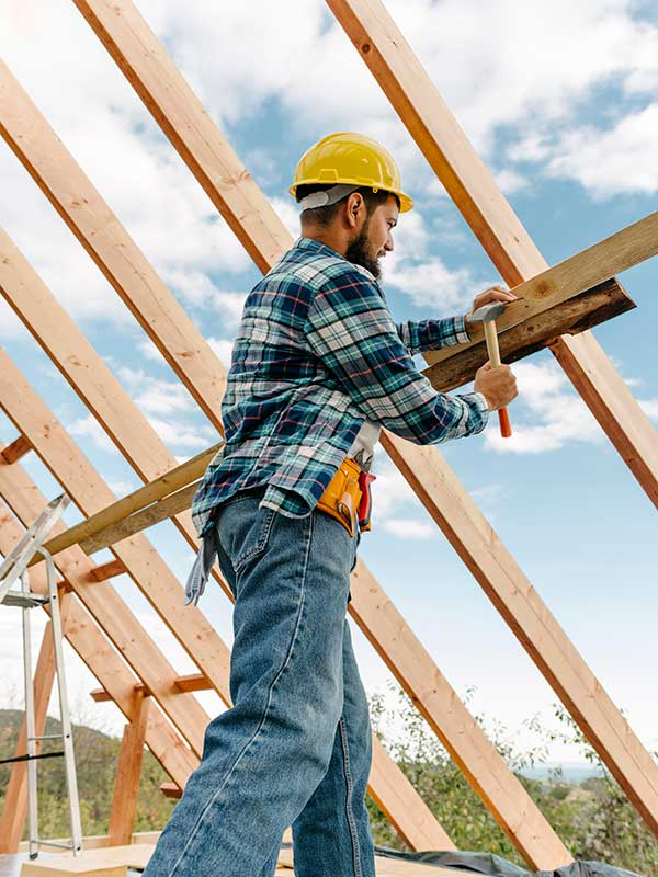construction worker with hard hat building roof house